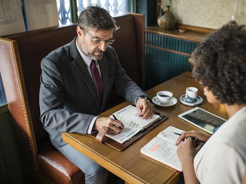 Interview At Restaurant Table. Virtual Assistants Benefits Risks