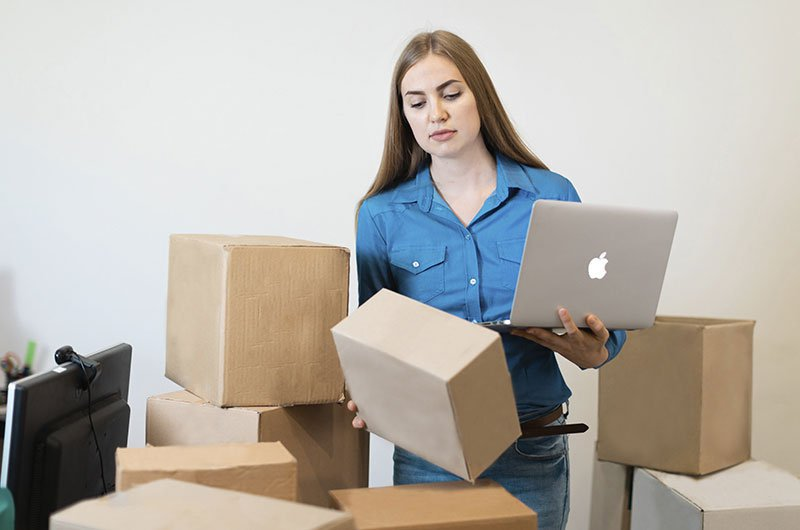 Girl With Boxes. Retail and ECommerce Industry Outsourcing Teams